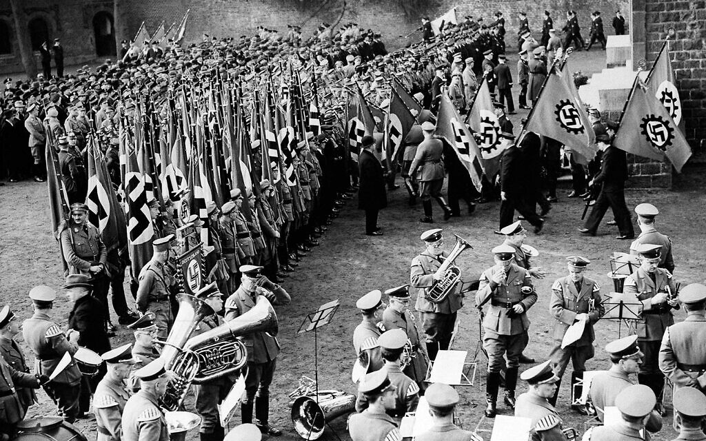 Nazi soldiers hold a colorful ceremony in Cologne, Germany, celebrating the reoccupation of the Rhineland, March 8, 1936. (AP)