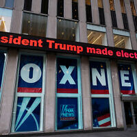 A headline about then US President Donald Trump outside Fox News studios, Nov. 28, 2018, in New York. (AP Photo/Mark Lennihan)