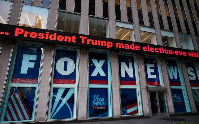 A headline about then US President Donald Trump outside Fox News studios, Nov. 28, 2018, in New York. (AP Photo/Mark Lennihan)
