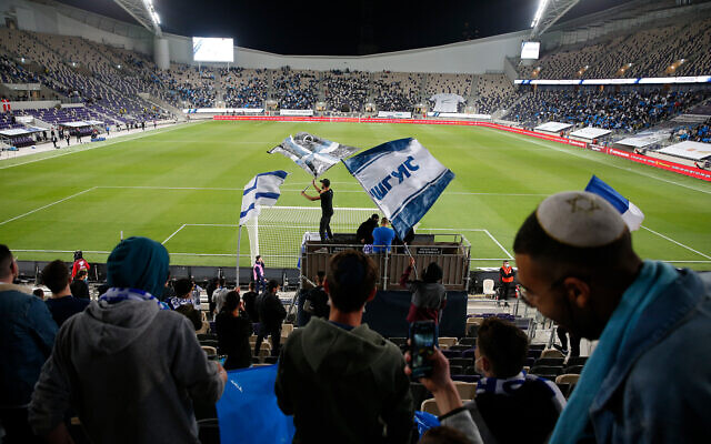 Israeli fans cheer before the World Cup 2022 group F qualifying soccer match between Israel and Denmark in Tel Aviv, March 25, 2021. (AP Photo/Ariel Schalit)