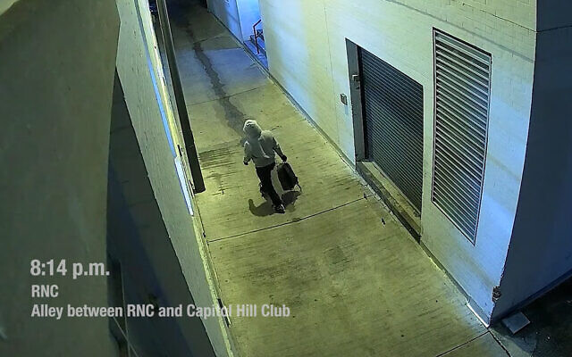 A man suspected of planting pipe bombs at political party headquarters in Washington, DC, on January 5, 2020, in surveillance footage released by the FBI. (Screenshot/YouTube)