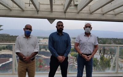 (L-R) Yesha Council director Yigal Dilmoni, Palestinian Workers Association chair Muhammad Arif Masad and Yesha Council chair David Elhayani in the Jordan Valley on March 15, 2021. (Yesha Council)
