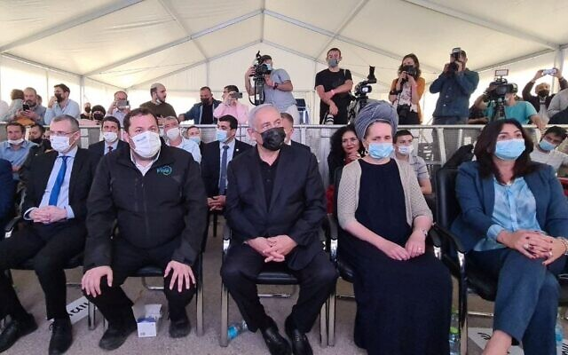 Prime Minister Benjamin Netanyahu (center) and members of his Likud party at an inauguration ceremony for a new neighborhood in the West Bank settlement of Revava, March 23, 2021. (Roy Hadi/Shomron Regional Council)