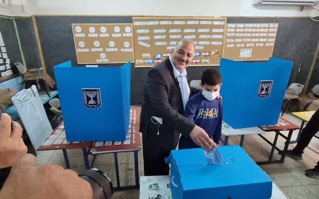 Ra'am party leader Mansour Abbas casts his vote in his hometown of Maghar in northern Israel, March 23, 2021. (Ra'am Spokesperson)