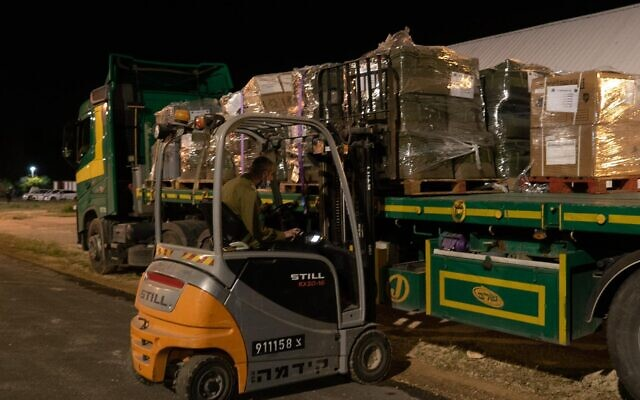 A forklift loads medical equipment onto an airplane on March 10, 2021, for an Israeli delegation heading to Equatorial Guinea following a massive explosion in the African country that injured hundreds. (Israel Defense Forces)