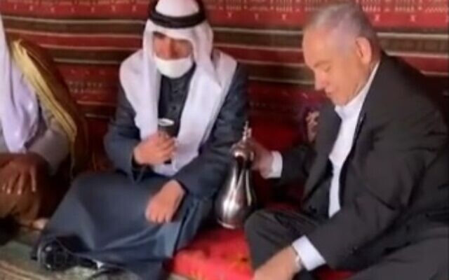 Prime Ministher Benjamin Netanyahu pours coffee for Bedouin leaders in southern Israel during a visit with members of the community, March 7, 2021. (video screenshot)