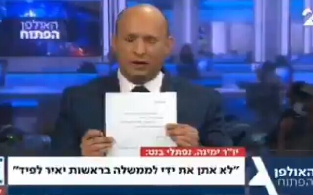 Bennett signs pledge not to join government with Yair Lapid as prime minister