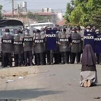 A nun in Myanmar pleads with police not to open fire on protesters (Myitkyiana News Journal)