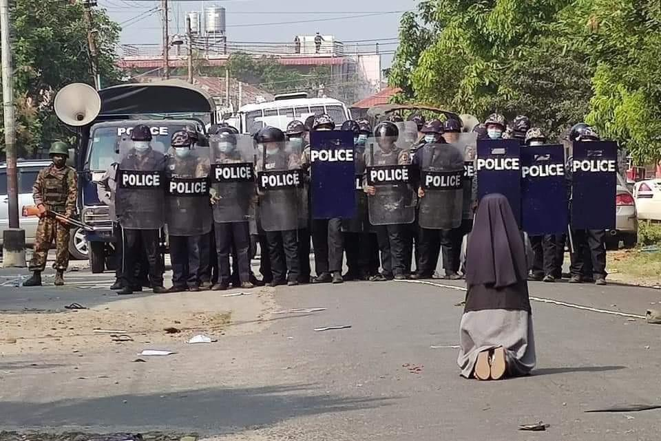 Iconic images emerge from Myanmar as nun blocks police from shooting protesters