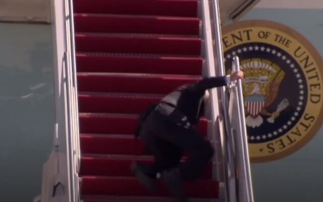 US President Joe Biden stumbles while walking up the steps to Air Force One, March 19, 2021 (video screenshot)
