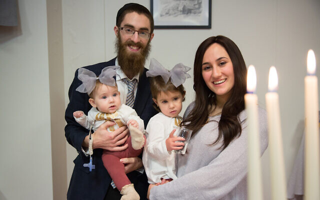 Rabbi Avi Feldman, left, and wife Mushky, with their two daughters, Chana and Batsheva, before moving to Iceland in 2018 to become the Chabad emissaries there. (Chabad.org via JTA)