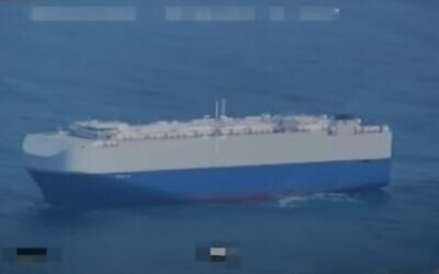 Screen capture from video allegedly showing Iranian drone footage of an Israeli-owned cargo ship that suffered damage from a mysterious explosion in the Persian Gulf. (YouTube)