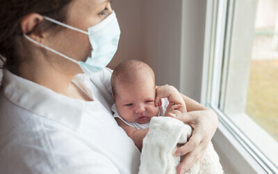 A baby, born during the pandemic, with the mother (vlada_maestro via iStock by Getty Images)