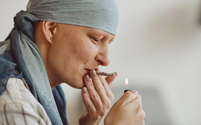 A woman smoking marijuana for medicinal purposes in cancer recovery (SeventyFour via iStock by Getty Images)