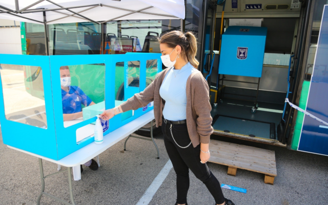 A bus converted into a polling station ahead of the Knesset elections, in a photo released March 8, 2021. (Chaim Levy/Central Elections Committee)