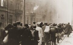 Jews marched out of the ghetto during Warsaw Ghetto Revolt in April and May, 1943 (public domain)