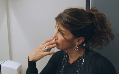 Gilly Regev, an Israeli-raised scientist who co-founded the company SaNOtize, uses the new nasal spray she developed (Screen grab)