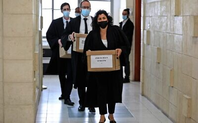 State attorneys carry boxes of files into a hearing in Prime Minister Benjamin Netanyahu's corruption trial at Jerusalem District Court on April 5, 2021. (POOL / AFP)