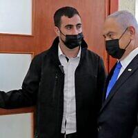 Prime Minister Benjamin Netanyahu leaves the courtroom at Jerusalem District Court on April 5, 2021, during his corruption trial. (Abir SULTAN / POOL / AFP)