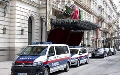 Police cars are seen near the entrance of the Grand Hotel in Vienna on April 6, 2021, where diplomats of the EU, China, Russia, and Iran held talks. (JOE KLAMAR / AFP)