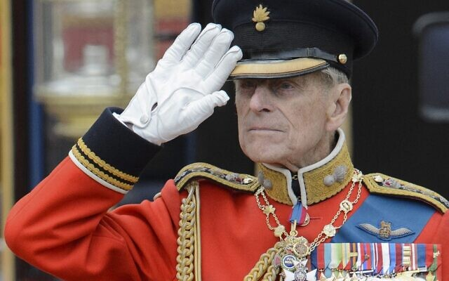 In this file photo taken on June 16, 2012 Britain's Prince Philip, Duke of Edinburgh salutes as he watches the troops ride past outside Buckingham Palace following the Queen's Birthday Parade in London on June 16, 2012 (LEON NEAL / AFP)