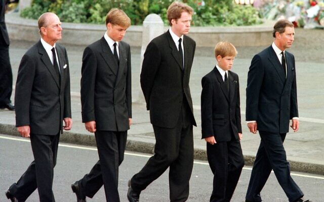 In this file photo taken on September 6, 1997 (L to R) Britian's Prince Philip, Duke of Edinburgh, Prince William, Earl Spencer, Prince Harry and Prince Charles, Prince of Wales, walk outside Westminster Abbey during the funeral service for Diana, Princess of Wales. (JEFF J MITCHELL / POOL / AFP)