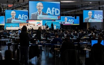 Joerg Urban, leader of the Far-right Alternative for Germany (AfD) in Saxony, is seen on displays as he gestures while addressing delegates during an AfD party congress in Dresden, eastern Germany, on April 10, 2021. (JENS SCHLUETER / AFP)