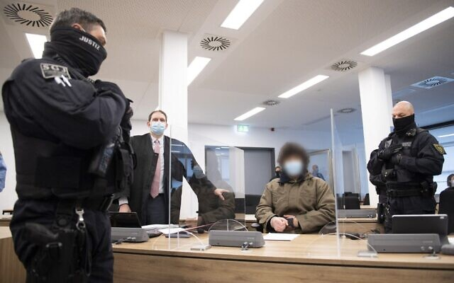 Defendant Abdullah A (C), accused of stabbing a German tourist to death in Dresden, sits next to judicial officials and his lawyer Peter Hollstein (2ndL) at the start of his trial at the Higher Regional Court in Dresden, eastern Germany, on April 12, 2021 (Sebastian Kahnert / POOL / AFP)