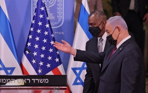 US Defence Secretary Lloyd Austin (L) and Israeli Prime Minister Benjamin Netanyahu arrive to give a statement after their meeting at the Premier's office in Jerusalem on April 12, 2021. (Menahem KAHANA / POOL / AFP)