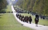 Members of the King's Troop Royal Horse Artillery ride up the Long Walk to Windsor Castle in Windsor, west of London, on April 17, 2021 for the funeral of Britain's Prince Philip, Duke of Edinburgh (PHIL NOBLE / POOL / AFP)