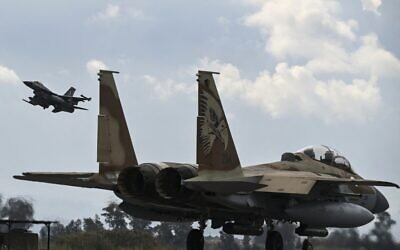 A Hellenic Air Force F-16 jet takes off behind an Israeli F-15 from the military airport of Andravida in southern Greece, as part of the Hellenic Air Force's 'INIOCHOS 2021' multinational aviation exercise on April 19, 2021. (ARIS MESSINIS / AFP)