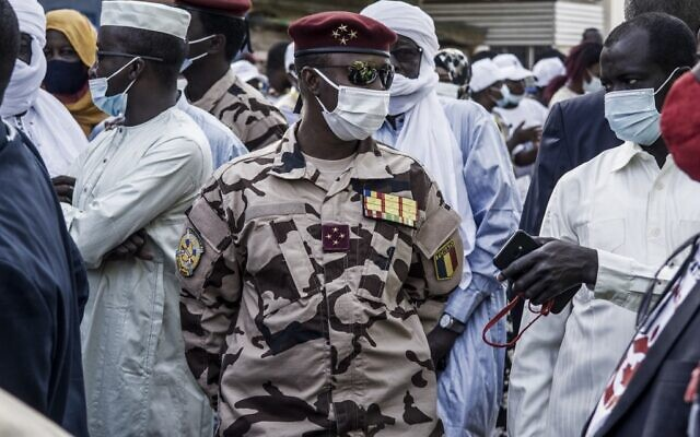 Four Star General and head of the Republican Guard in Chad, Mahamat Idriss Deby Itno (C), 37, son of Chadian President Idriss Deby Itno, is seen at a polling station in N'djamena, April 11, 2021. (Photo by MARCO LONGARI / AFP)