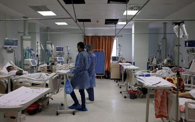 This picture taken on April 22, 2021 shows a general view of nurses and patients at the COVID-19 coronavirus intensive care unit at the Turkish-Palestinian Friendship Hospital in Gaza City. (Emmanuel DUNAND / AFP)