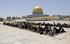 Palestinians gather during the second Friday prayers of the Muslim fasting month of Ramadan, at the Al-Aqsa Mosque  on the Temple Mount on April 23, 2021. (Ahmad Gharabli/AFP)