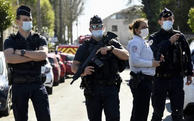 French police officials block off a street near the police station in Rambouillet, south-west of Paris, on April 23, 2021, after a woman was stabbed to death. (Bertrand Guay/AFP)