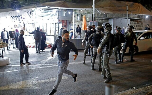 A Palestinian protester runs from Israeli security forces outside Damascus Gate in Jerusalem's Old City on April 23, 2021 (Ahmad GHARABLI / AFP)