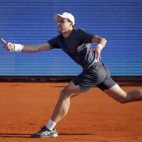 Russia's Aslan Karatsev plays a forehand return to Serbia's Novak Djokovic during their ATP 250 Serbia Open semi-final singles tennis match at The Novak Tennis Centre in Belgrade on April 24, 2021. (PEDJA MILOSAVLJEVIC / AFP)