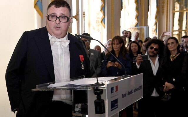 In this file photo taken on October 03, 2016 Israeli-US fashion designer Alber Elbaz delivers a speech after he received the title of Officer in the National Order of Merit by French Culture minister at the Culture ministry in Paris on October 3, 2016. (CHRISTOPHE ARCHAMBAULT / AFP)