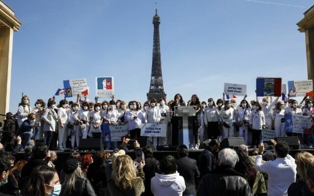 Members of the support committee of late Sarah Halimi gather to ask justice on Trocadero plaza in front of the Eiffel Tower in Paris on April 25, 2021.  (Photo by GEOFFROY VAN DER HASSELT / AFP)