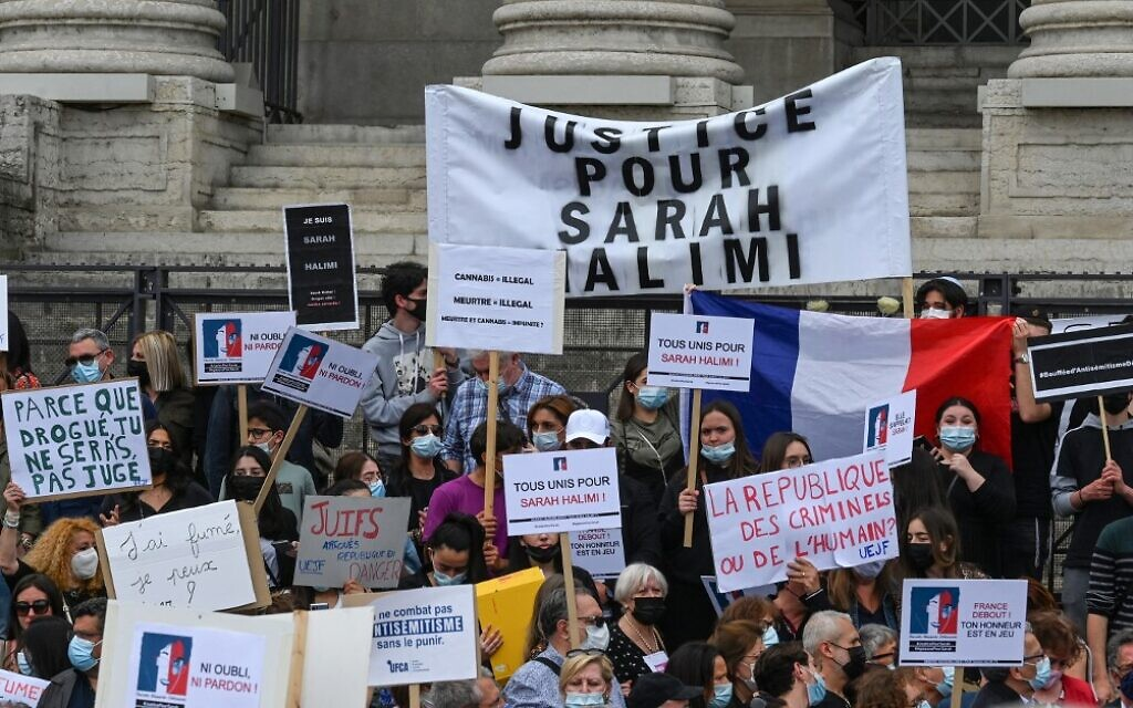 People hold placards during a protest against the recent decision by France's highest court that murderer of Sarah Halimi was not criminally responsible, in Lyon, south-central France, on April 25, 2021. (PHILIPPE DESMAZES / AFP)