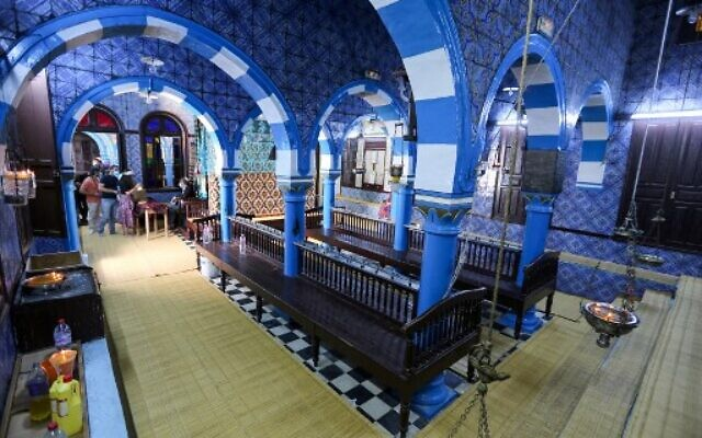 Jewish pilgrims arrive on the first day of the annual pilgrimage to the Ghriba Synagogue, the oldest Jewish monument built in Africa, on April 26, 2021 in the Mediterranean Tunisian resort island of Djerba.(Photo by FATHI NASRI / AFP)