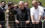 Prime Minister Benjamin Netanyahu and Internal Security Minister Amir Ohana (R)  visit the site of an overnight fatal crush during a religious gathering at Mt. Meron in northern Israel, on April 30, 2021. (Ronen ZVULUN / POOL / AFP)