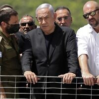 Prime Minister Benjamin Netanyahu and Internal Security Minister Amir Ohana (R)  visit the site of an overnight fatal stampede during an ultra-Orthodox religious gathering at Mt. Meron in northern Israel, on April 30, 2021. (Ronen ZVULUN / POOL / AFP)