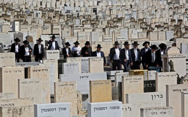 Mourners attend the funeral of one of the victims of the deadly Meron crush at Segula cemetery in Petah Tikva on April 30, 2021.(GIL COHEN-MAGEN / AFP)