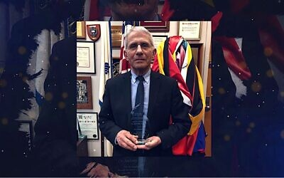 Antony Fauci poses with an award from the March of the Living in a broadcast posted by the Holocaust remembrance group on April 7, 2021. (YouTube)