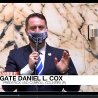 Maryland Del. Daniel Cox, sporting a mask with a Nuremberg trials theme, explains why he is voting against a law that would allow children to consent to mental health care, during a vote in Annapolis, April 8, 2021. (Maryland General Assembly video screenshot)