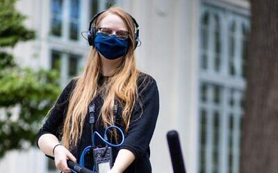 Aviva Okeson-Haberman on the job as a reporter for KCUR in Kansas City, September 2020. (Brandon Parigo via JTA)