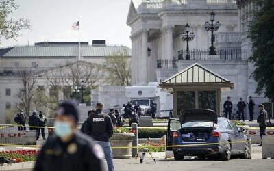Law enforcement investigate the scene after a vehicle charged a barricade at the U.S. Capitol on April 02, 2021 in Washington, DC. (Drew Angerer/Getty Images/AFP)