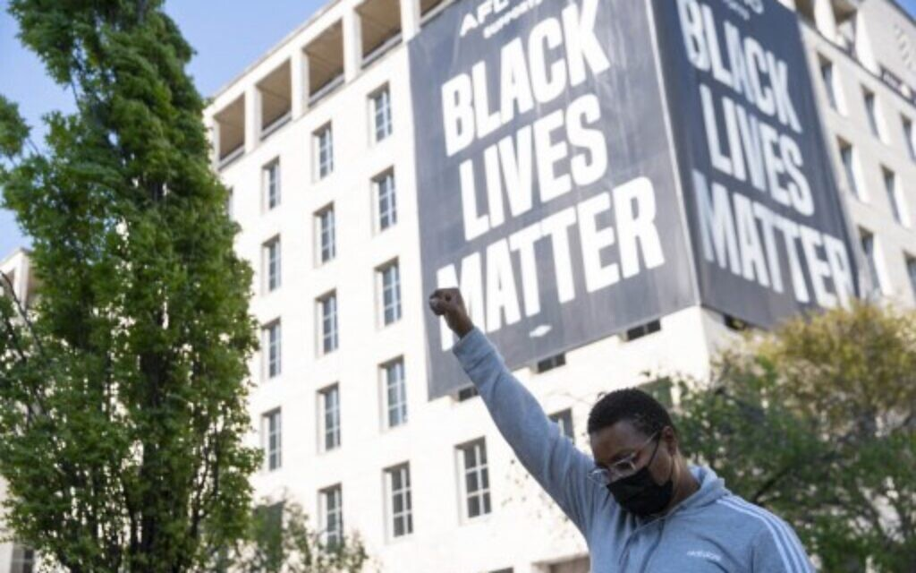 A person celebrates the verdict of the Derek Chauvin trial at Black Lives Matter Plaza near the White House on April 20, 2021 in Washington, DC. (Sarah Silbiger/Getty Images/AFP)