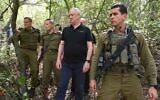 Defense Minister Benny Gantz (C) touring the Lebanese border area with senior IDF commanders, April 20, 2021. (Ariel Hermony/Defense Ministry)